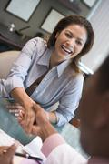 Woman shaking doctor's hand at IVF clinic (selective focus) Stock Photos