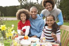 Family painting easter eggs in gardens Stock Photos