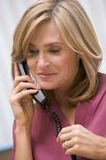 Consultant phoning client with good news - stock photo