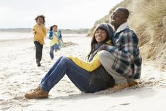 Family having fun on winter beach Stock Photos