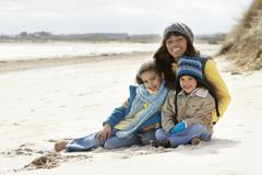 Mother and children on winter beach Stock Photos