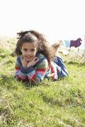 young girl sitting outside in caravan park - stock photo