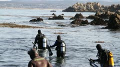 scuba divers enter water - stock footage