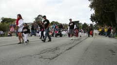 families with children walk in parade - stock footage