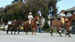Cowboys with horses and mules in parade - stock footage