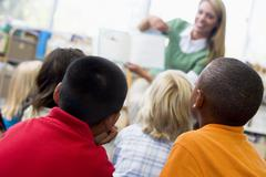 Students in class with teacher reading to them (depth of field) Stock Photos