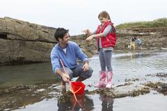 Family with seaweed Stock Photos