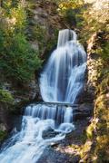 Waterfall with autumn foliage Stock Photos