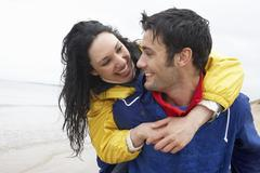 happy couple on beach in love - stock photo