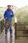 young man with umbrella - stock photo