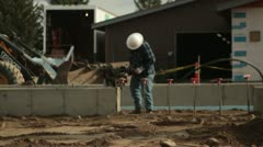 Construction worker with tamper Stock Footage
