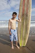 Teenage boy with surfboard Stock Photos
