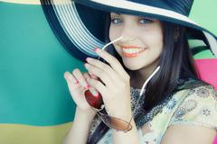 face of  young beautiful brunette woman in a hat - stock photo