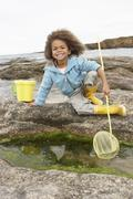 happy boy with fishing net - stock photo
