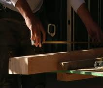 Worker measures wood Stock Footage