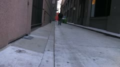 Alley, man walking Stock Footage