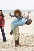 happy family playing on beach - stock photo