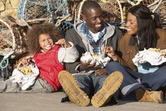 Happy family having picnic Stock Photos