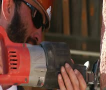 Construction worker uses power tool Stock Footage