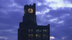 Time lapse of clouds moving behind a clock tower Stock Footage