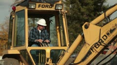 construction worker operates backhoe - stock footage