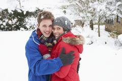 Stock Photo of young couple in snow