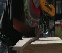 Man operates chop saw Stock Footage
