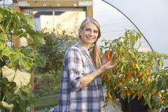 Woman working in greenhouse Stock Photos