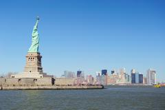 statue of liberty faces new york city manhattan - stock photo