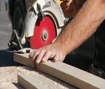 man operates circular saw - stock footage