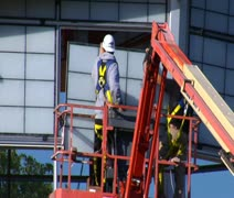 man in hardhat installs Windows - stock footage