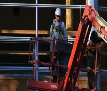 Man in Cherry Picker Crane descends Stock Footage