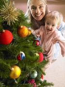 Mother and daughter with christmas tree Stock Photos