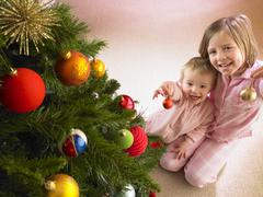 children with christmas tree - stock photo