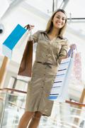 Woman standing in mall smiling (selective focus) Stock Photos