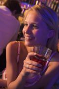 Young woman in a bar - stock photo