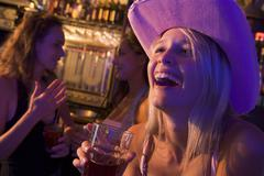 Stock Photo of Young woman in a bar