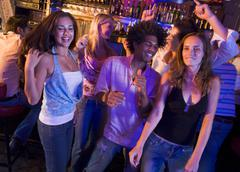 Young people dancing in a bar Stock Photos