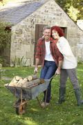 couple working in country garden - stock photo