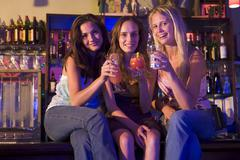 Young women in a bar - stock photo