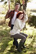Couple with country garden swing Stock Photos
