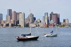 boston downtown skyline with boat - stock photo