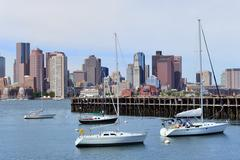 sailing boat and boston downtown - stock photo