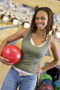 Woman at a bowling lane - stock photo