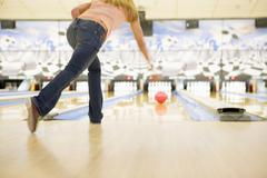 Woman bowling Stock Photos