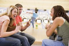 Man bowling with friends Stock Photos