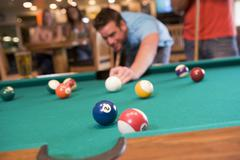 Man playing pool - stock photo