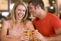 Couple having beer together Stock Photos