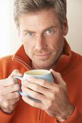 man with hot drink - stock photo