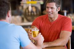 Two men having beer together Stock Photos